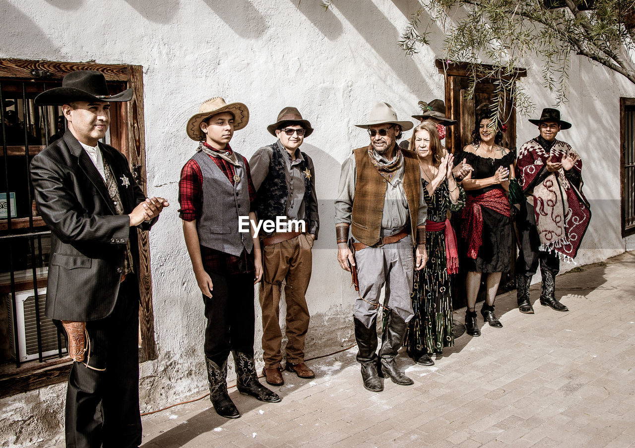 group of people, clothing, full length, real people, people, men, women, architecture, adult, males, standing, hat, portrait, day, mature adult, females, fashion, built structure, mature men, front view
