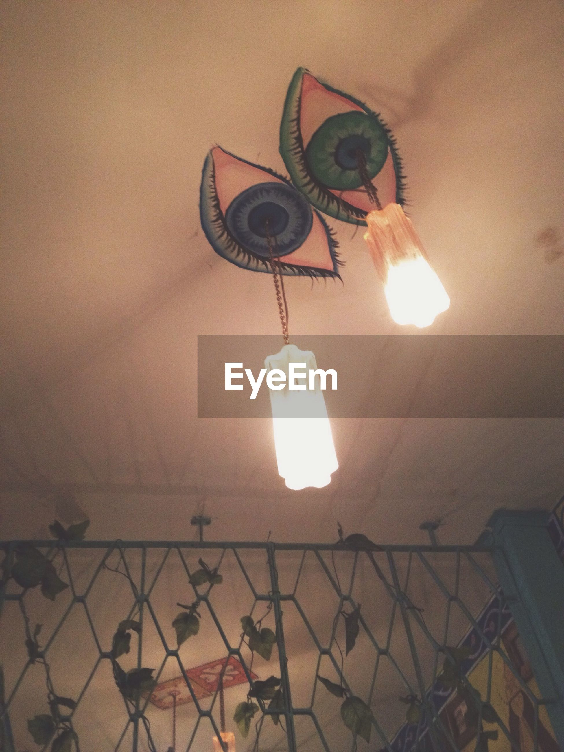 lighting equipment, indoors, illuminated, electricity, hanging, ceiling, electric lamp, electric light, low angle view, lamp, glowing, decoration, wall - building feature, light bulb, light - natural phenomenon, home interior, lantern, lit, chandelier, no people