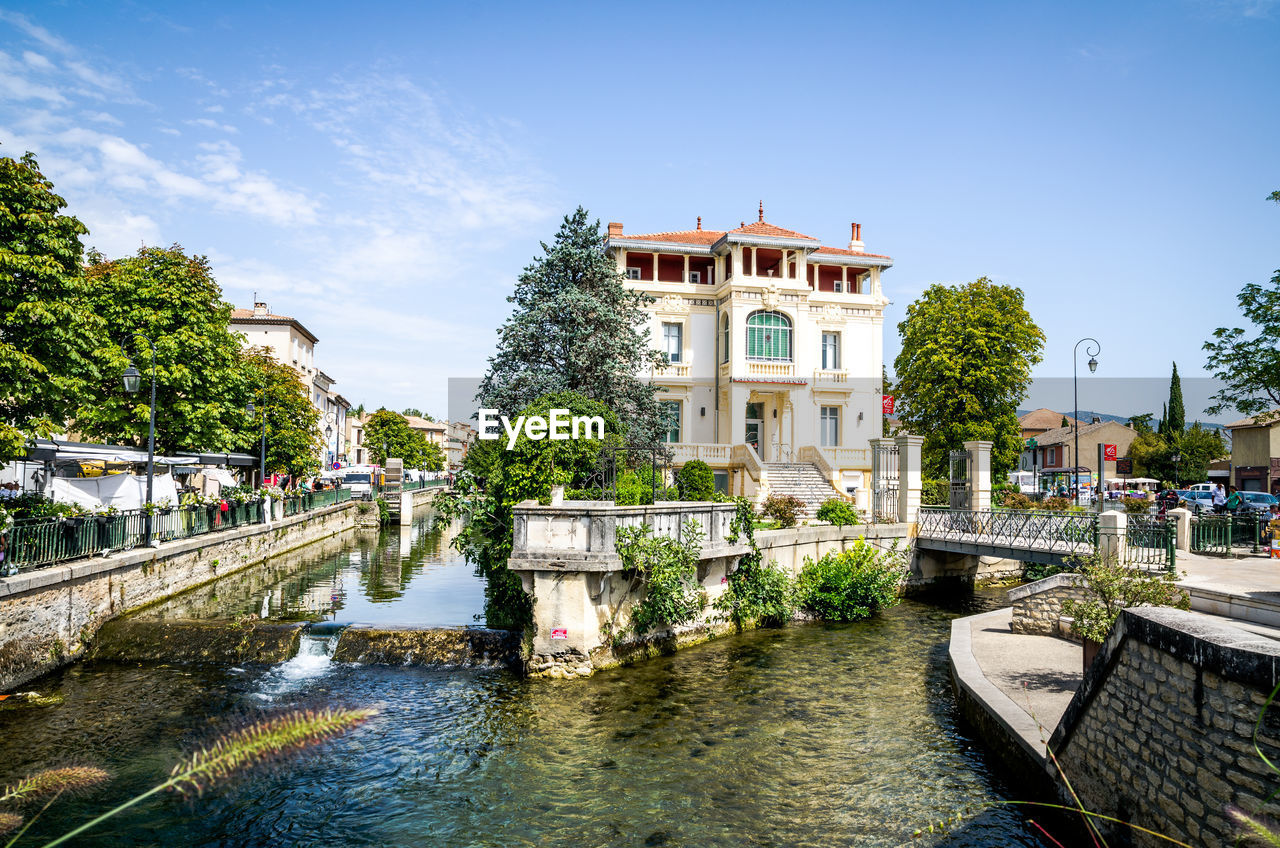 architecture, water, building exterior, built structure, day, tree, sky, outdoors, waterfront, travel destinations, bridge - man made structure, no people, nature