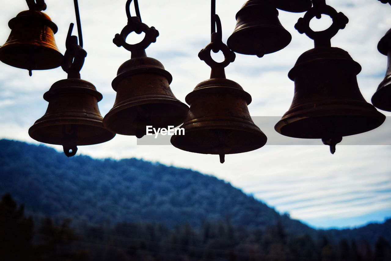 hanging, low angle view, focus on foreground, sky, no people, outdoors, lantern, day, close-up, nature