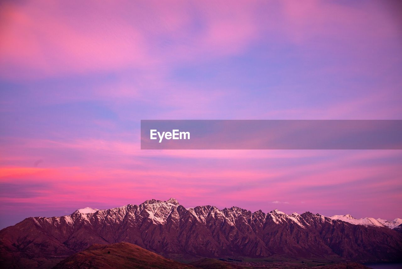 mountain, beauty in nature, sky, scenics - nature, cloud - sky, sunset, mountain range, tranquil scene, cold temperature, tranquility, snow, winter, non-urban scene, environment, nature, idyllic, no people, landscape, outdoors, snowcapped mountain, formation, purple, mountain peak