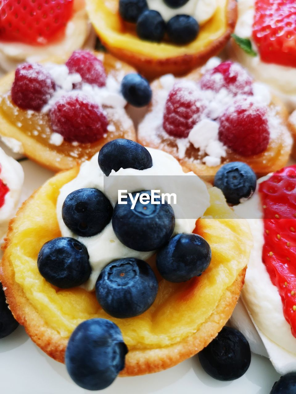 food, food and drink, fruit, berry fruit, blueberry, freshness, healthy eating, sweet, sweet food, close-up, still life, indulgence, dessert, ready-to-eat, temptation, indoors, raspberry, no people, cake, wellbeing, breakfast, meal, tart - dessert, garnish