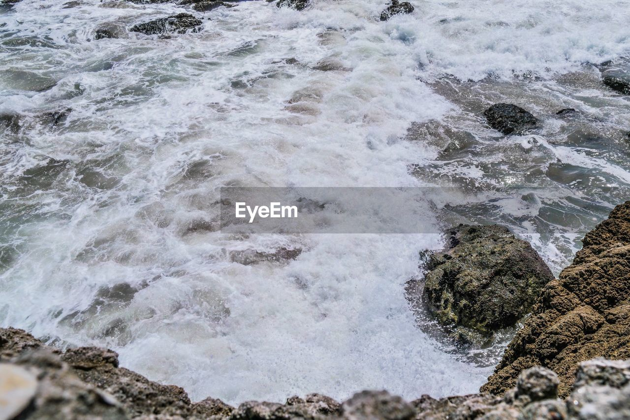 water, wave, motion, sea, surf, nature, beauty in nature, rock - object, day, power in nature, no people, high angle view, outdoors, beach, scenics, force