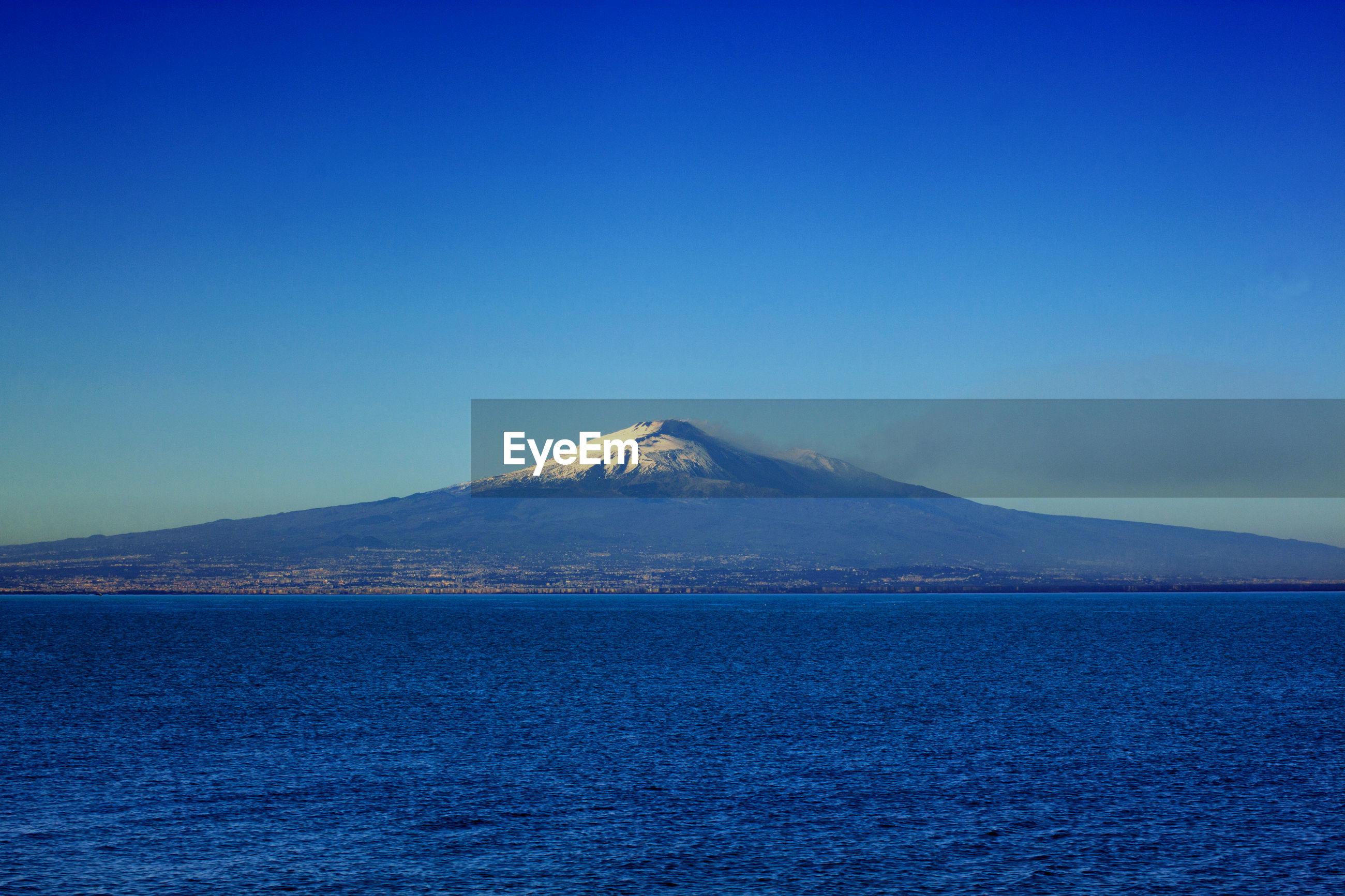 Etna mother overlooking the mediterranean