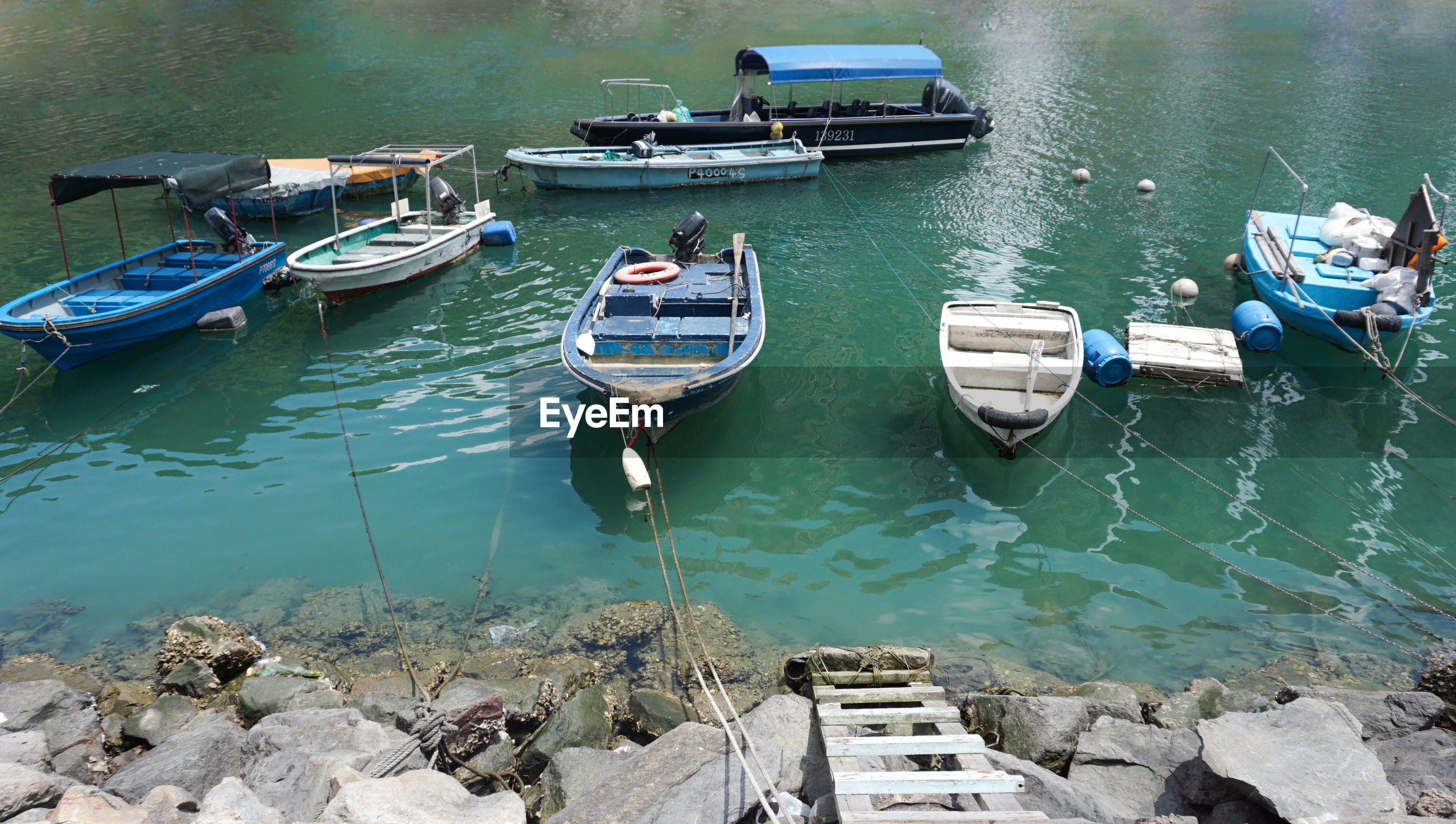 High angle view of boats moored on river