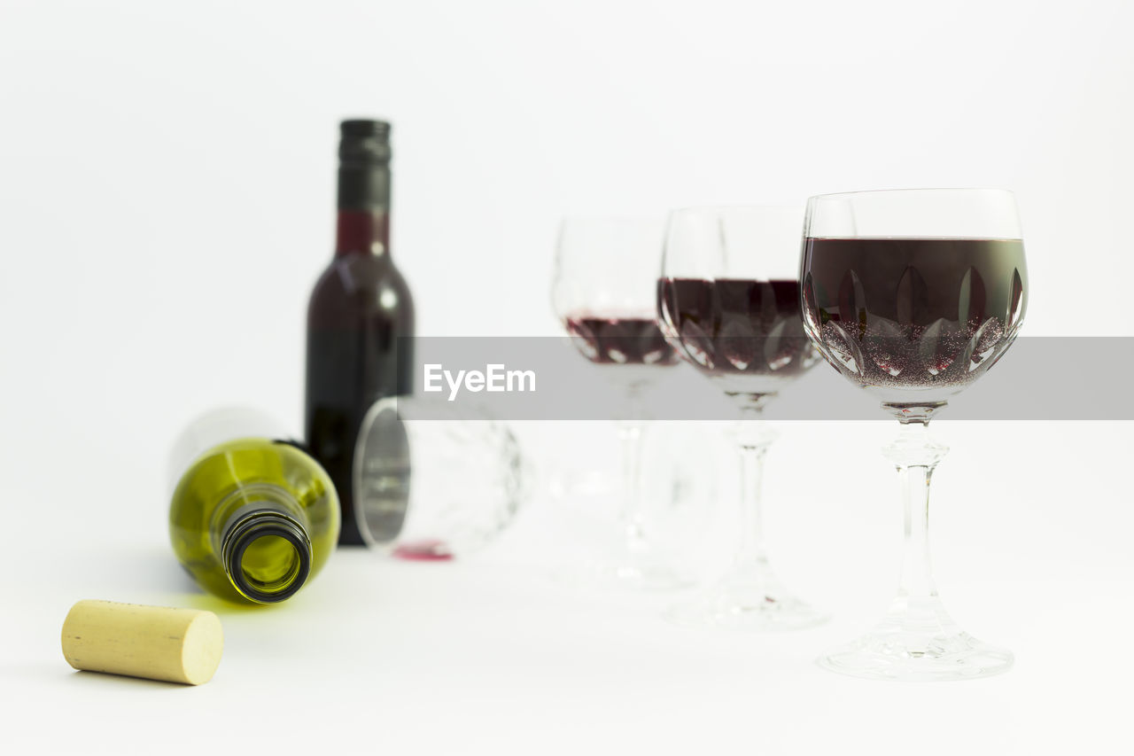 drink, alcohol, refreshment, wine, glass, bottle, food and drink, still life, wineglass, glass - material, container, studio shot, indoors, white background, no people, table, wine bottle, transparent, red wine, close-up