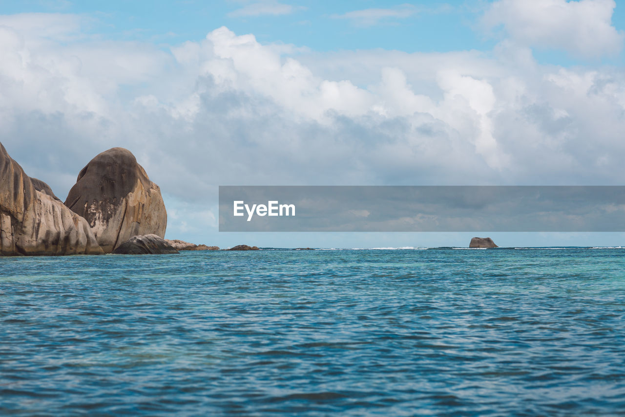 sea, beauty in nature, water, scenics - nature, sky, cloud - sky, waterfront, tranquil scene, tranquility, no people, idyllic, day, nature, non-urban scene, outdoors, rock, rippled, remote, land, marine, turquoise colored