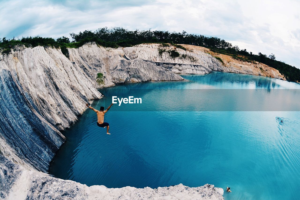 Scenic View Of Person Jumping Into Water
