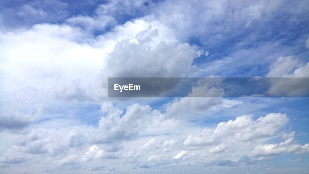 cloud - sky, sky, nature, beauty in nature, cloudscape, scenics, tranquility, sky only, low angle view, backgrounds, tranquil scene, no people, day, full frame, outdoors, blue