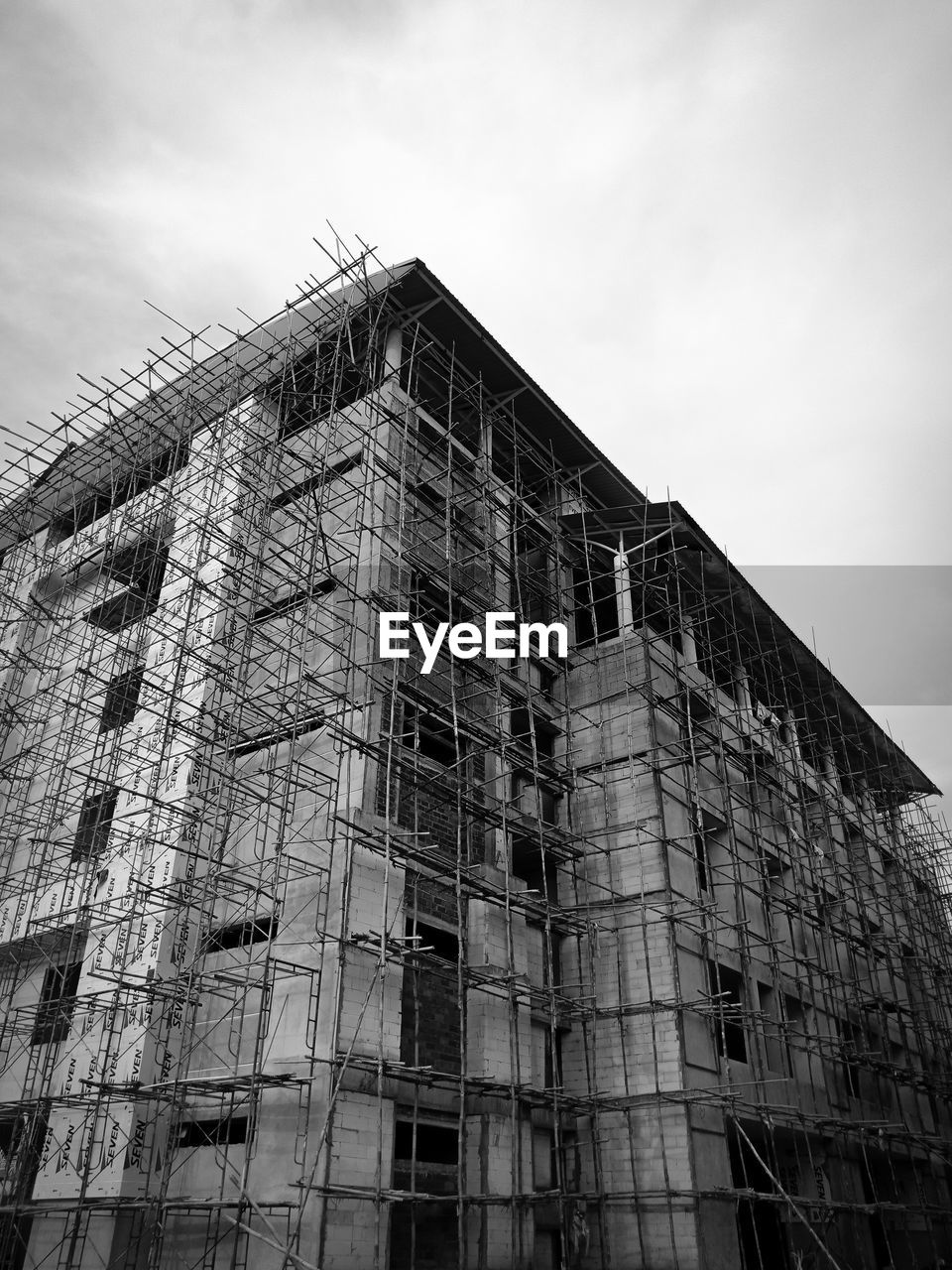 built structure, low angle view, architecture, building exterior, sky, building, cloud - sky, day, nature, no people, outdoors, window, construction site, history, construction industry, industry, city, old, the past, incomplete