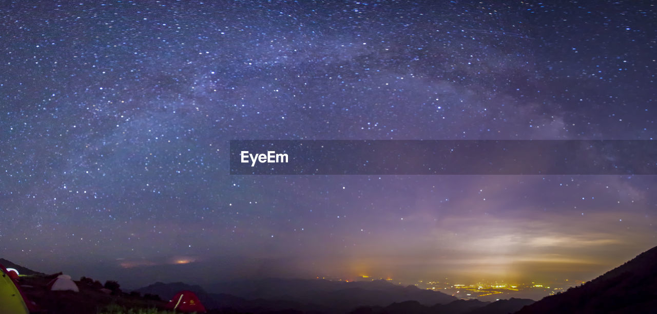SCENIC VIEW OF MOUNTAIN AGAINST STAR FIELD