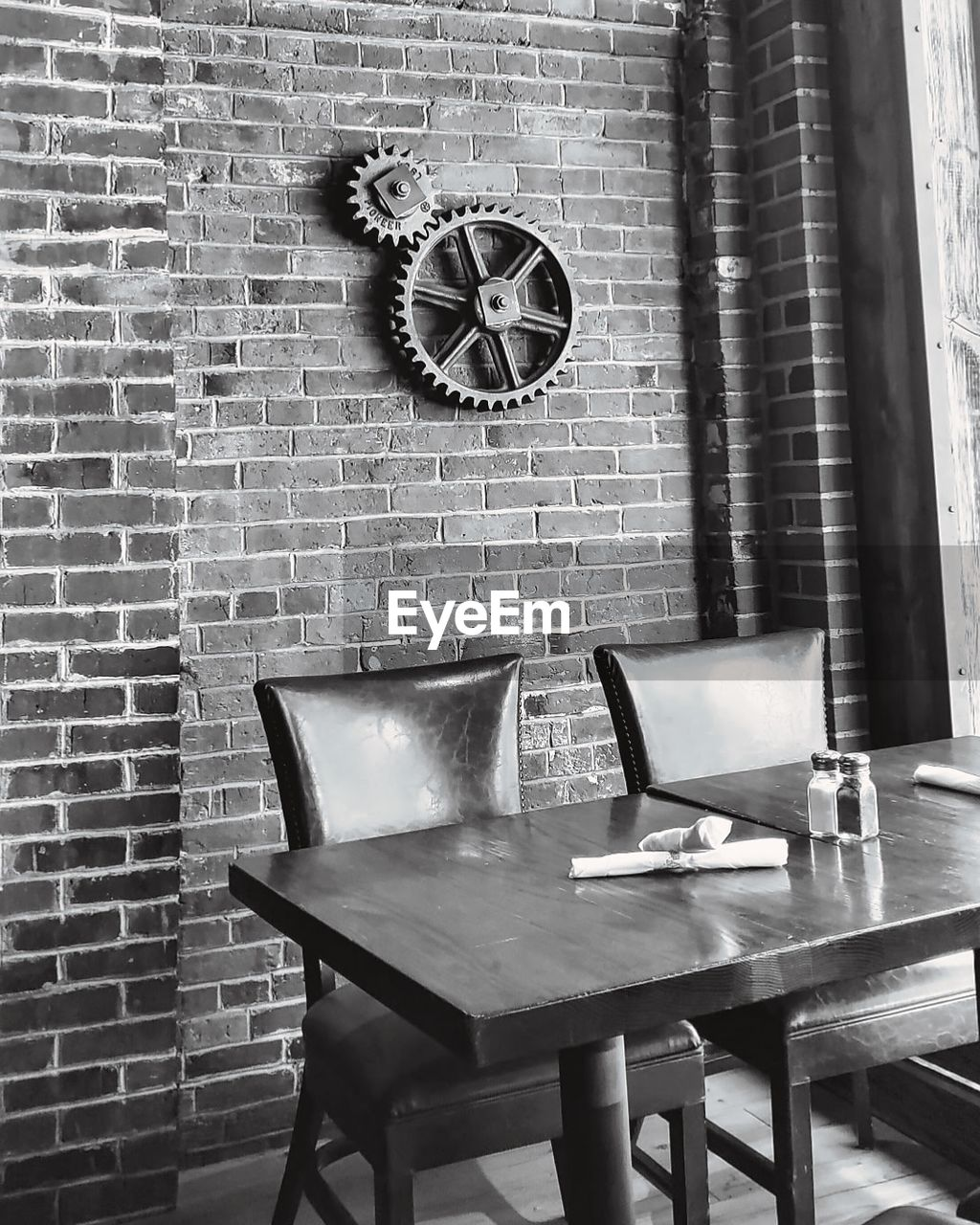 table, brick, brick wall, wall - building feature, wall, no people, absence, indoors, clock, chair, seat, empty, time, business, still life, nature, architecture, day, arrangement, restaurant, electric lamp, clock face