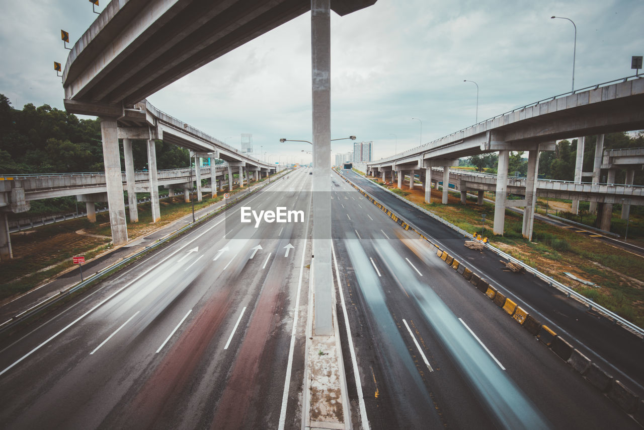 Blurred Motion Of Vehicles On Multiple Lane Highway Below Bridge