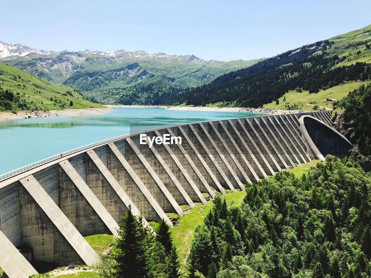 mountain, water, dam, tree, plant, hydroelectric power, sky, beauty in nature, scenics - nature, nature, no people, non-urban scene, day, renewable energy, tranquil scene, tranquility, environmental conservation, green color, fuel and power generation, mountain range, outdoors, flowing water