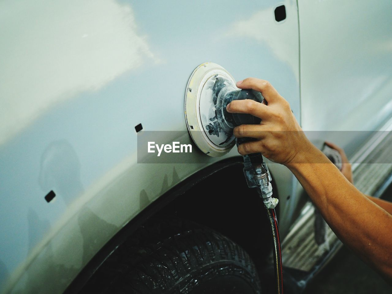 Cropped Image Of Hand Buffing Car