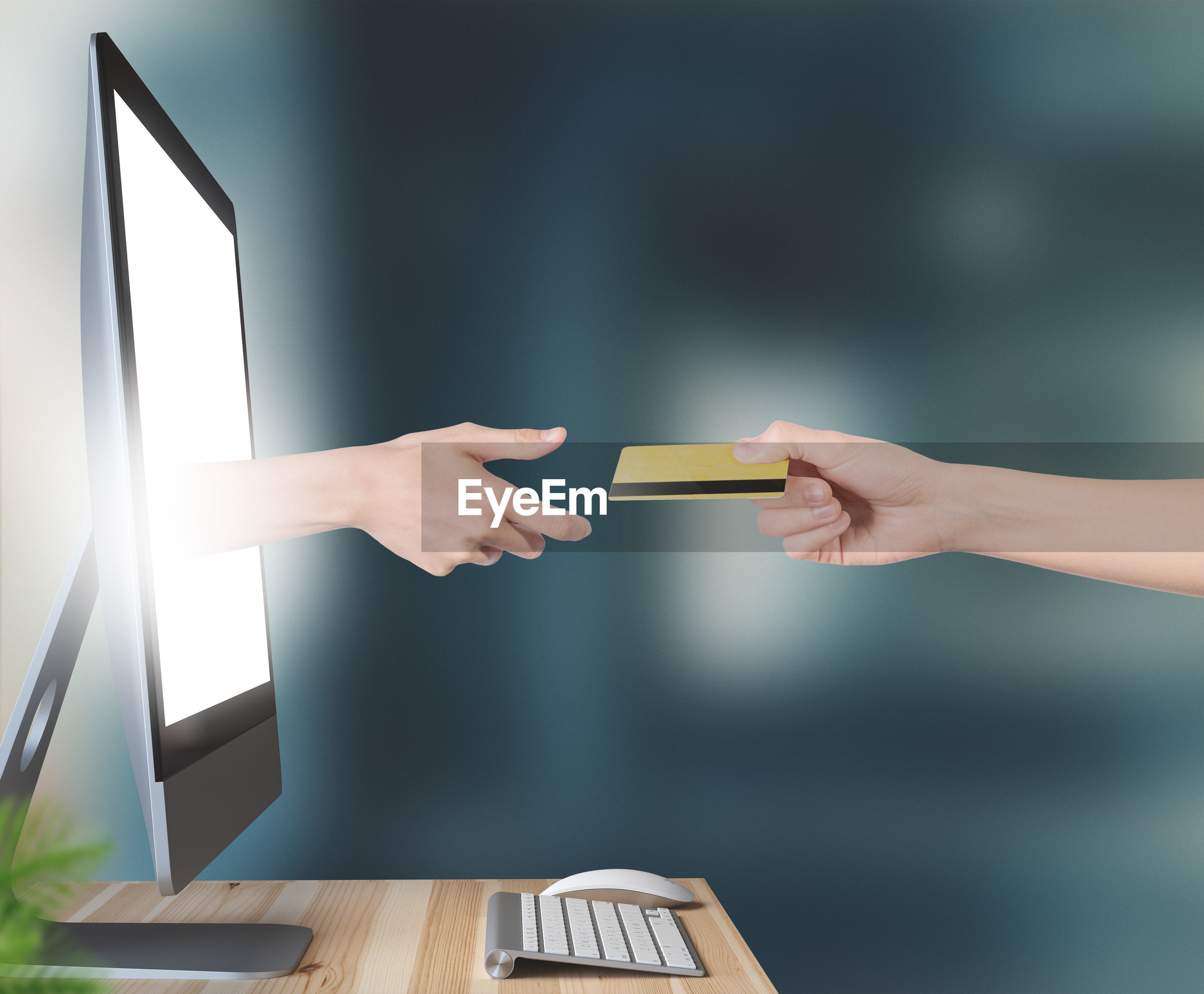 Digital composite image of hand giving credit card to computer