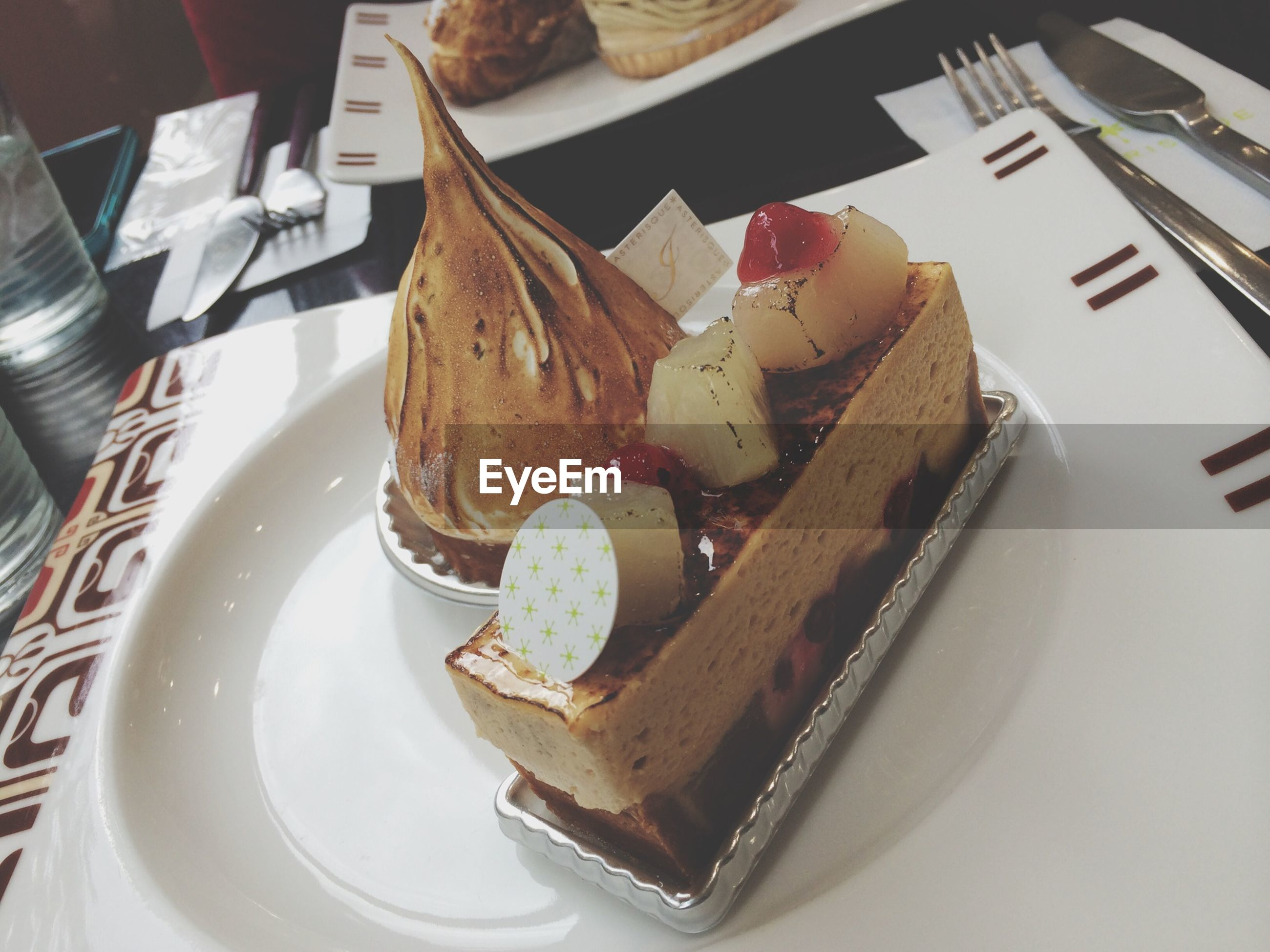 indoors, food and drink, food, plate, still life, sweet food, high angle view, ready-to-eat, dessert, freshness, indulgence, table, cake, chocolate, fork, unhealthy eating, serving size, temptation, close-up, no people