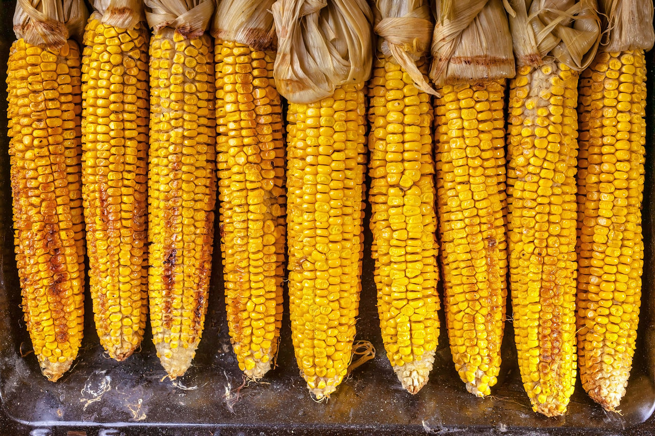 Close-Up Of Corn For Sale At Market Stall
