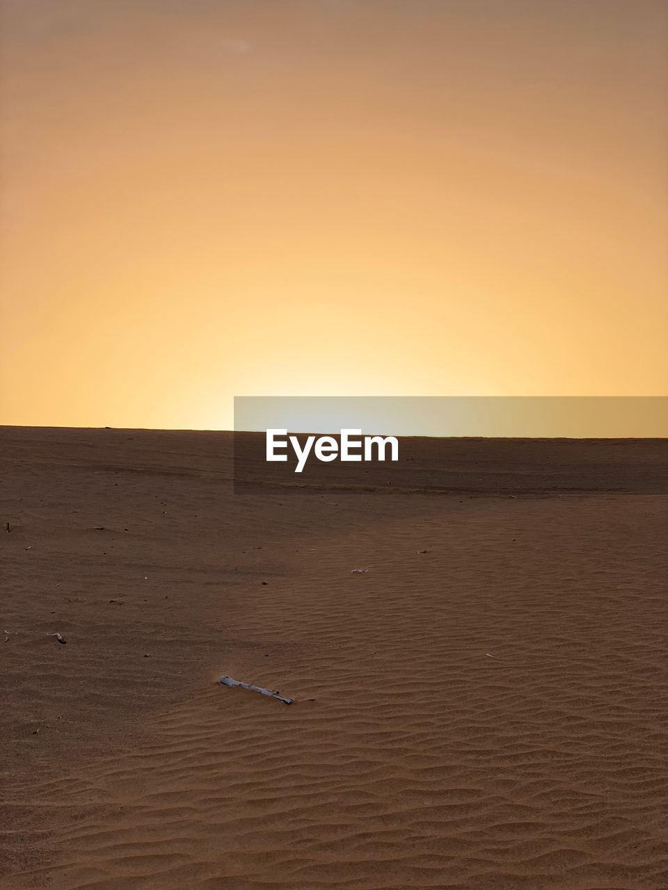 sky, scenics - nature, horizon, sunset, tranquility, beauty in nature, tranquil scene, no people, land, copy space, landscape, non-urban scene, clear sky, horizon over land, nature, environment, desert, remote, sea, arid climate, climate