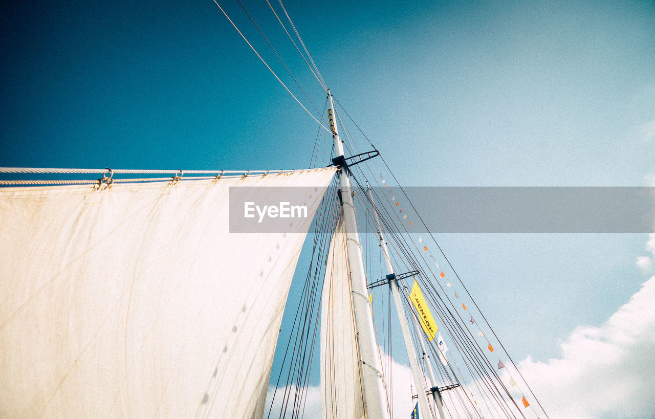 low angle view, sky, transportation, outdoors, day, no people, blue, mast, nautical vessel, nature