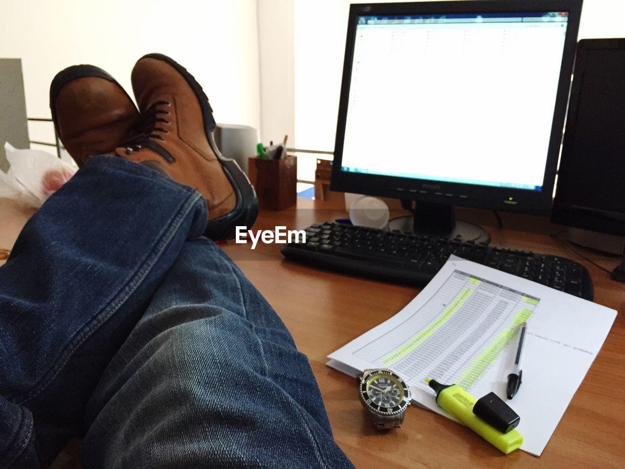 Man's Legs On Table