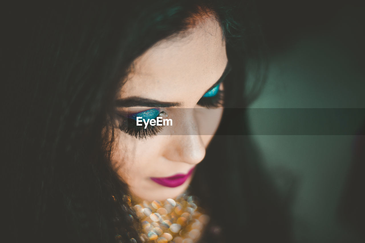 Close-up of beautiful young woman wearing make-up