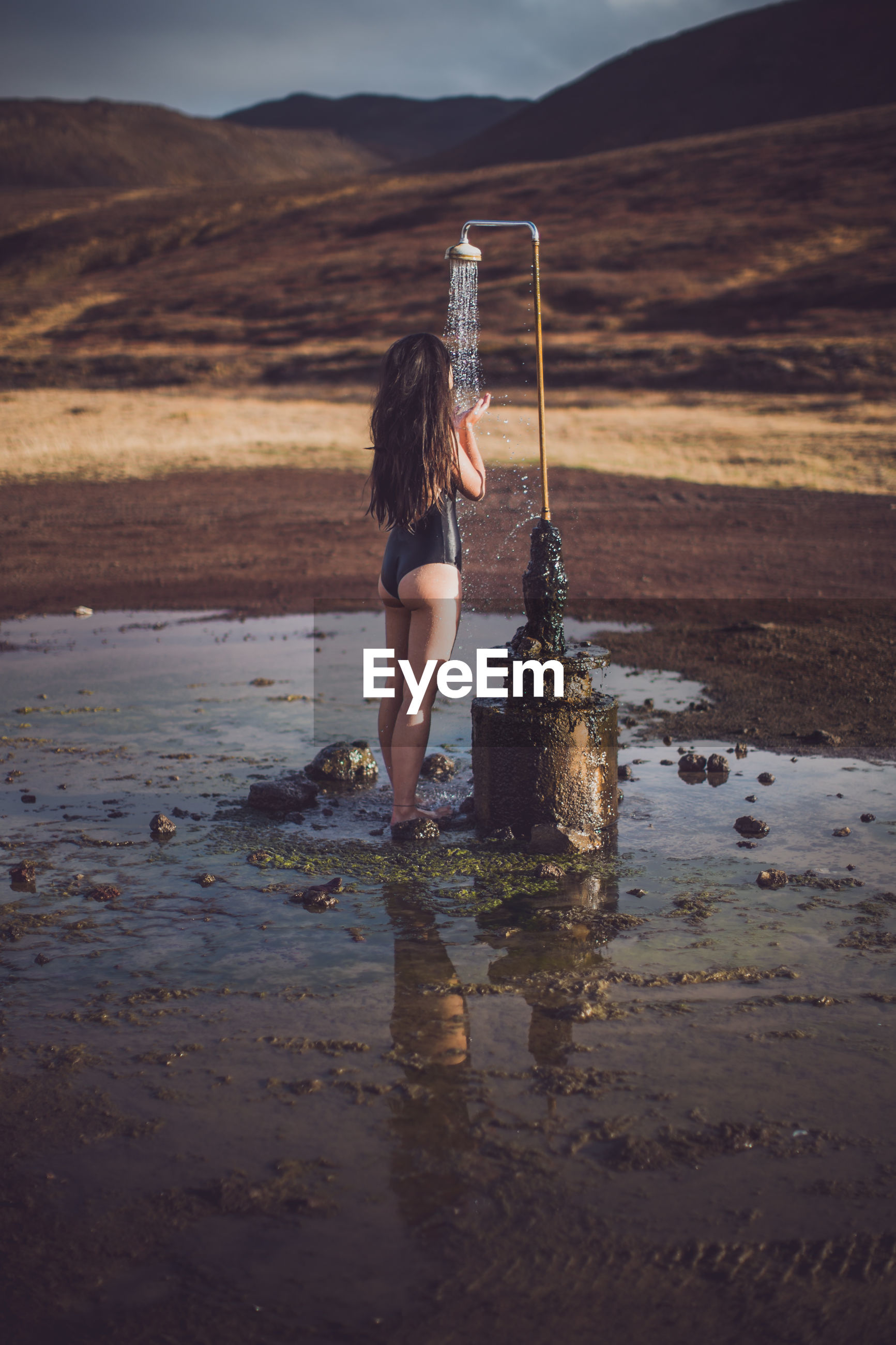 Girl showering outdoors