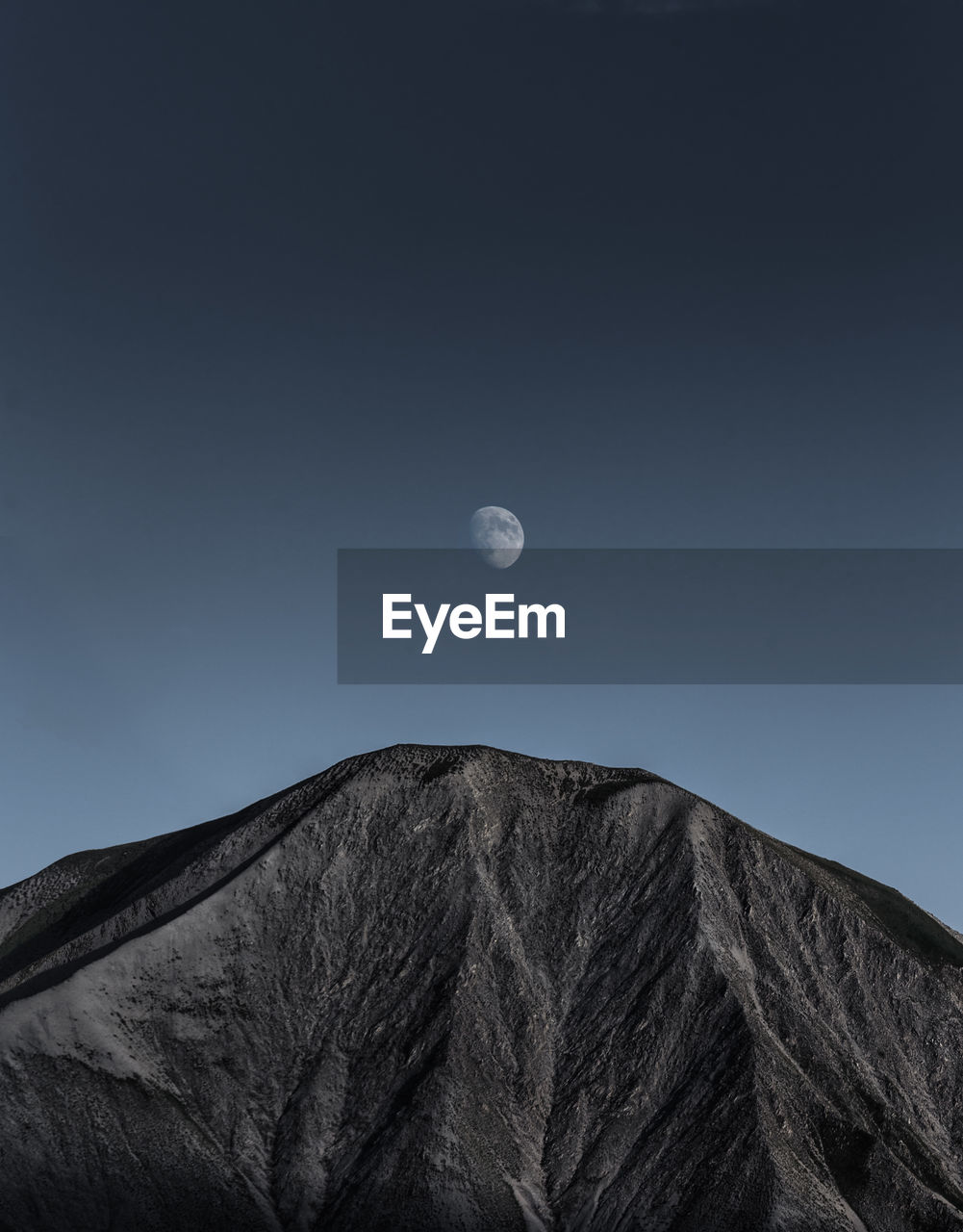 Low Angle View Of Mountain Against Clear Sky At Dusk