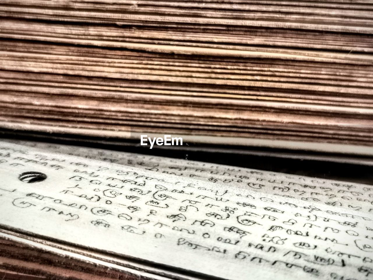HIGH ANGLE VIEW OF TEXT WRITTEN ON OLD PAPER