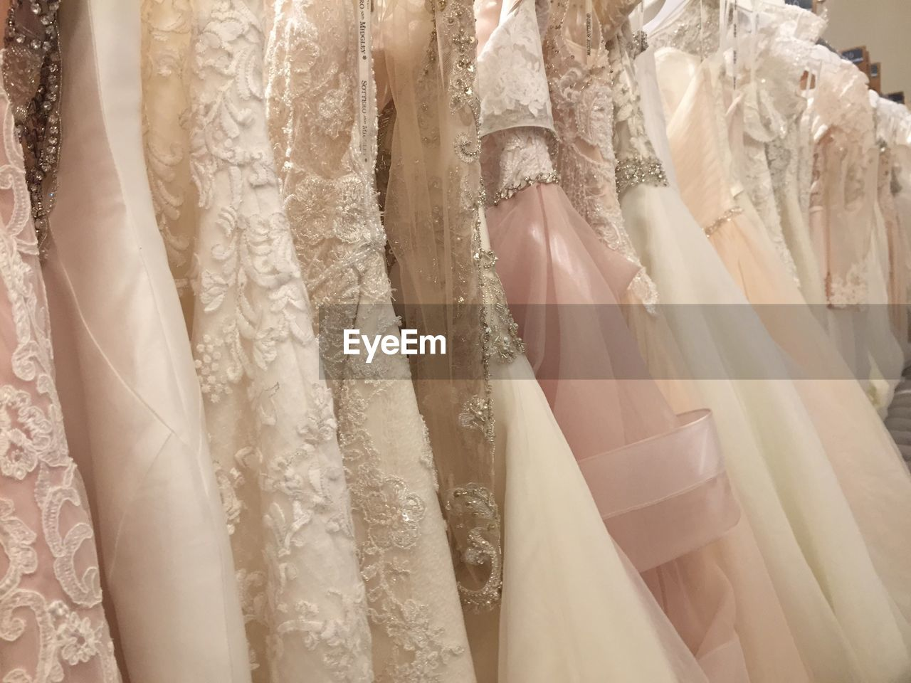 retail, store, wedding dress, wedding, backgrounds, white color, textile, fashion, indoors, bride, bridal shop, formalwear, close-up, day
