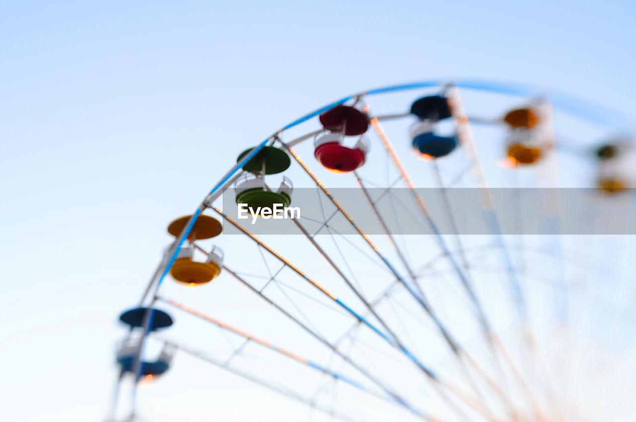 Close-up of ferris wheel against sky