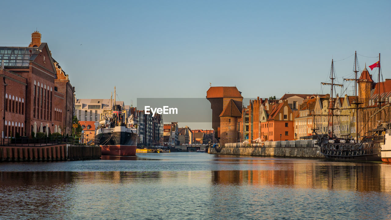 building exterior, architecture, built structure, water, sky, city, waterfront, building, transportation, river, nautical vessel, nature, clear sky, religion, copy space, residential district, place of worship, no people, travel, outdoors, passenger craft
