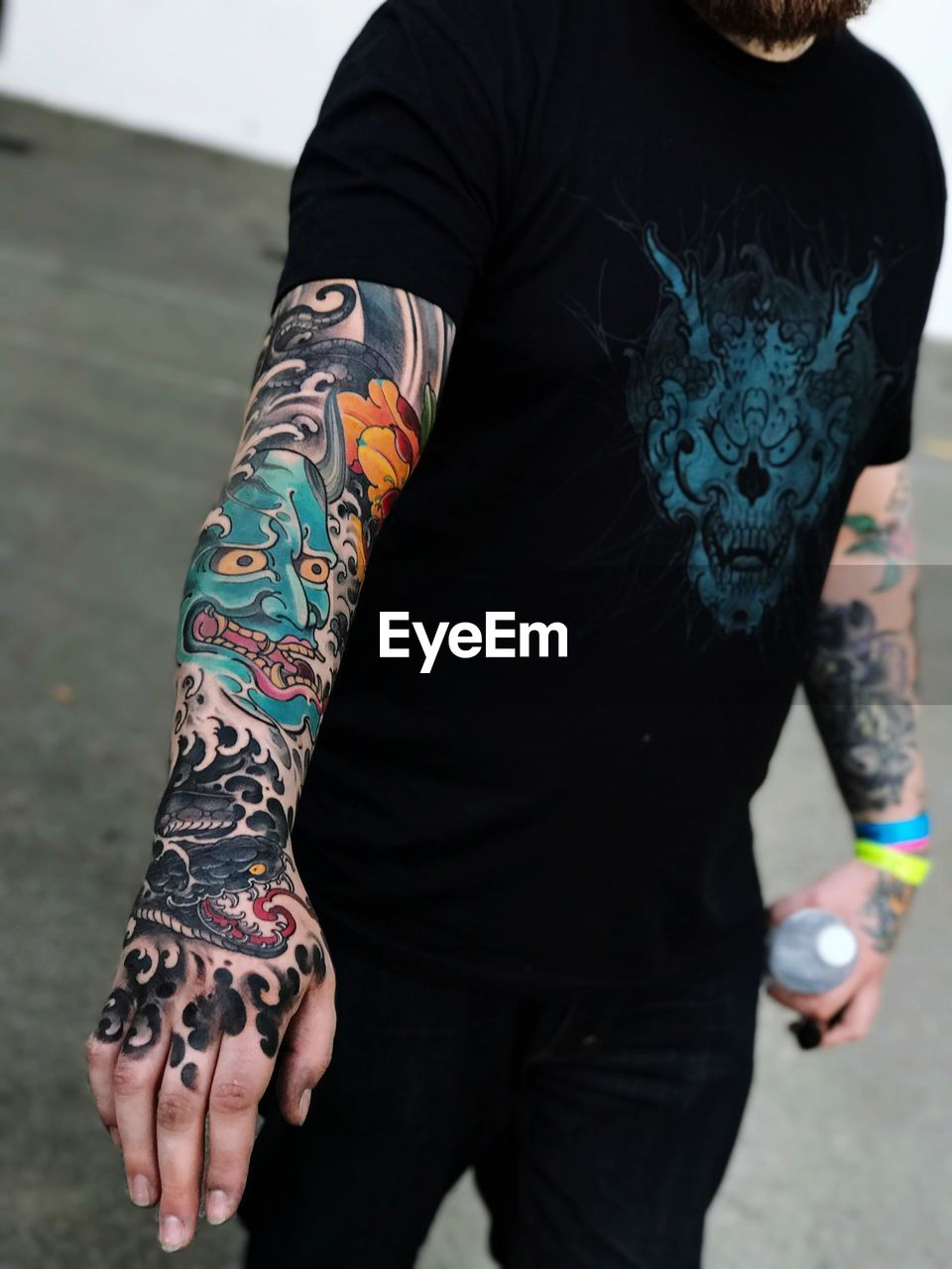 Midsection Of Man Showing Colorful Tattoo