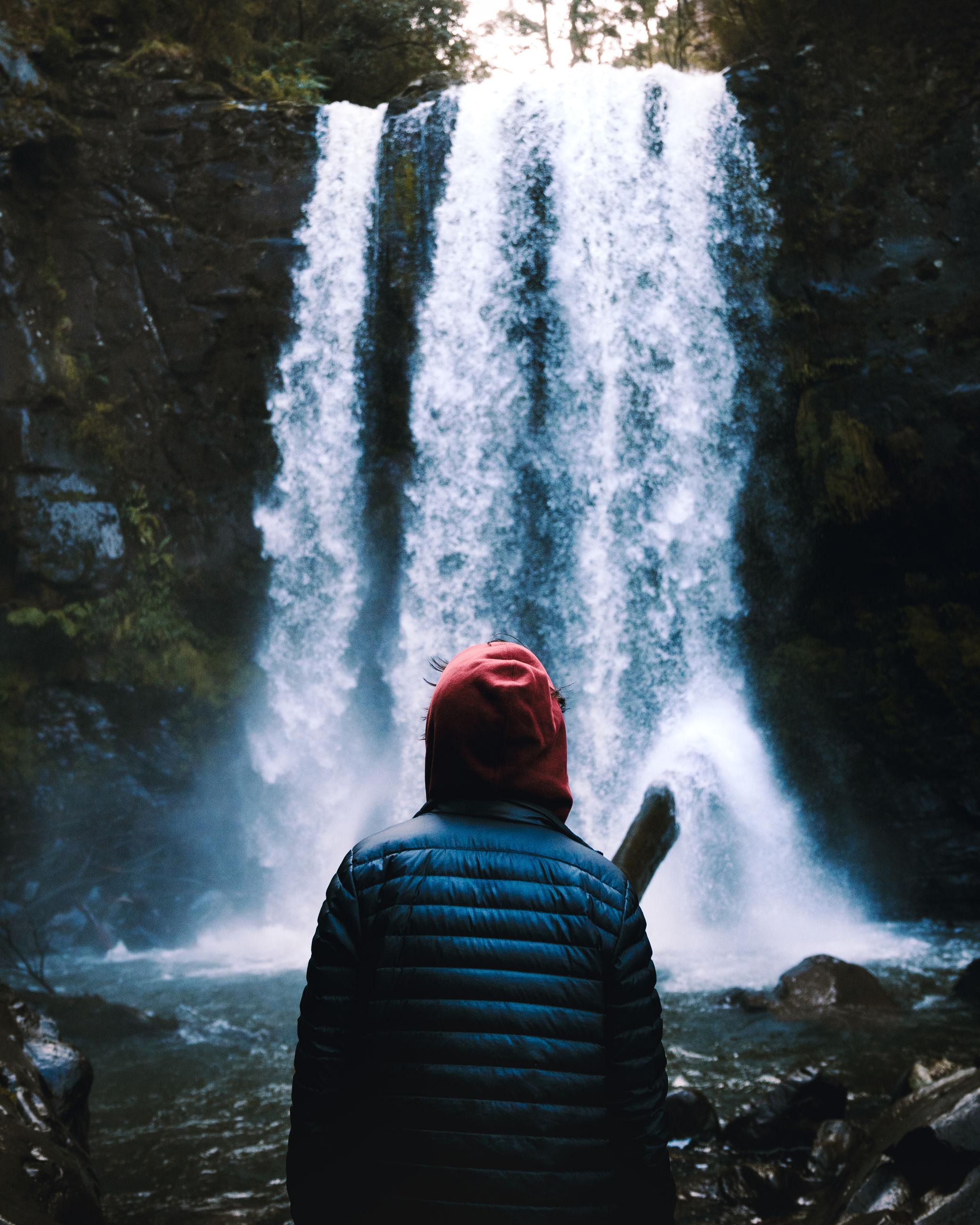 REAR VIEW OF MAN SPLASHING WATER