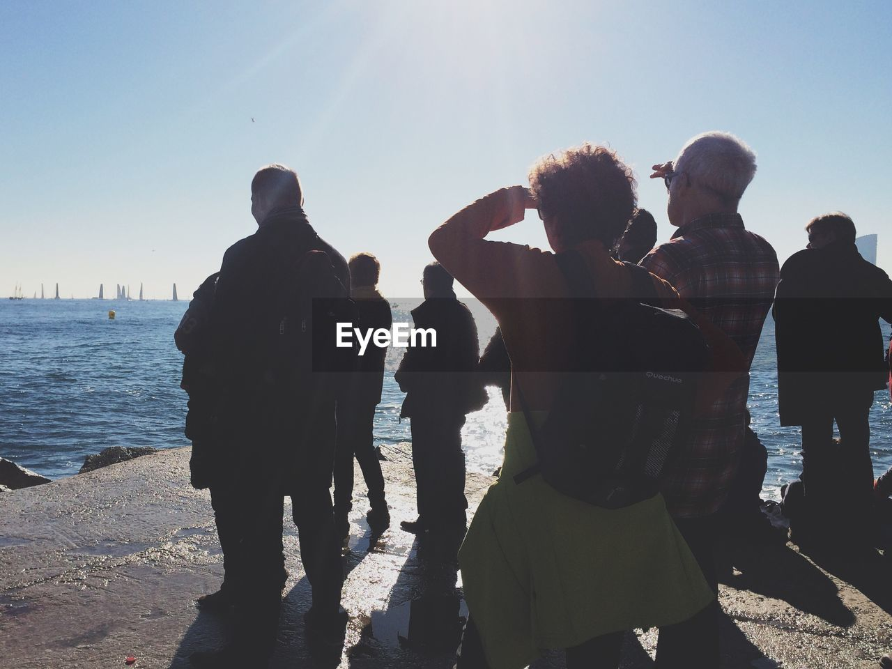 Group Of People Looking At Sea