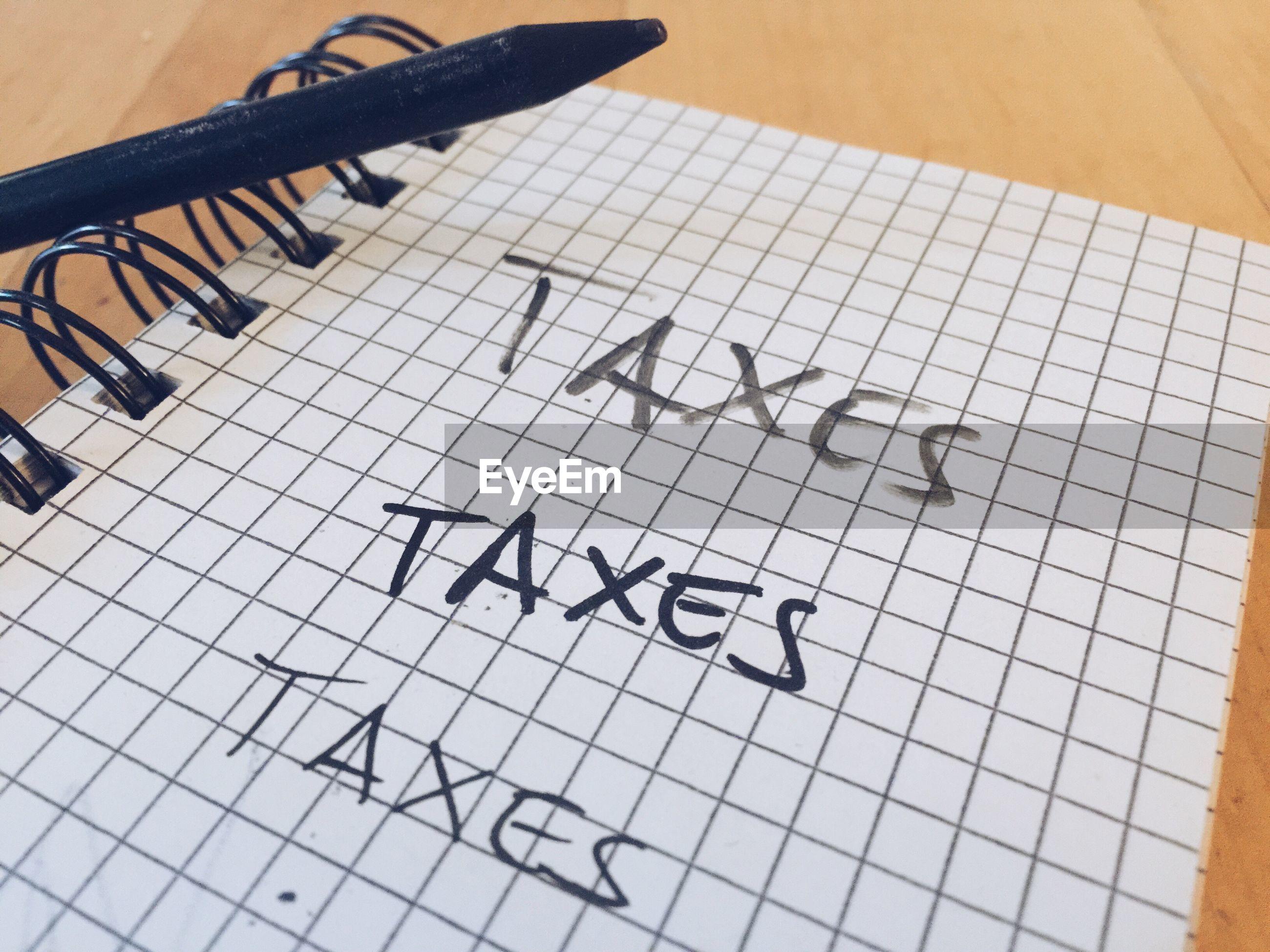 Taxes written on diary