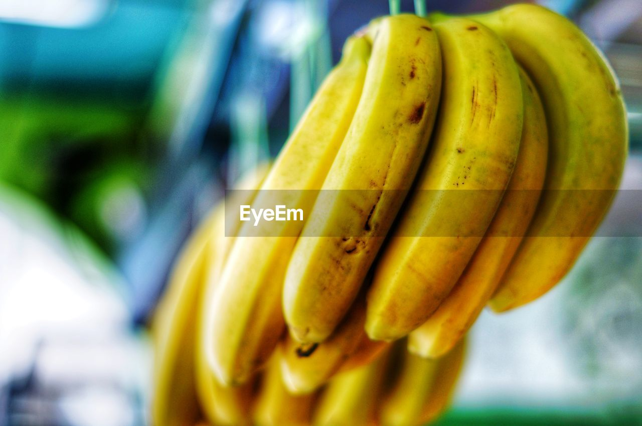 CLOSE-UP OF BANANAS FOR SALE IN MARKET STALL
