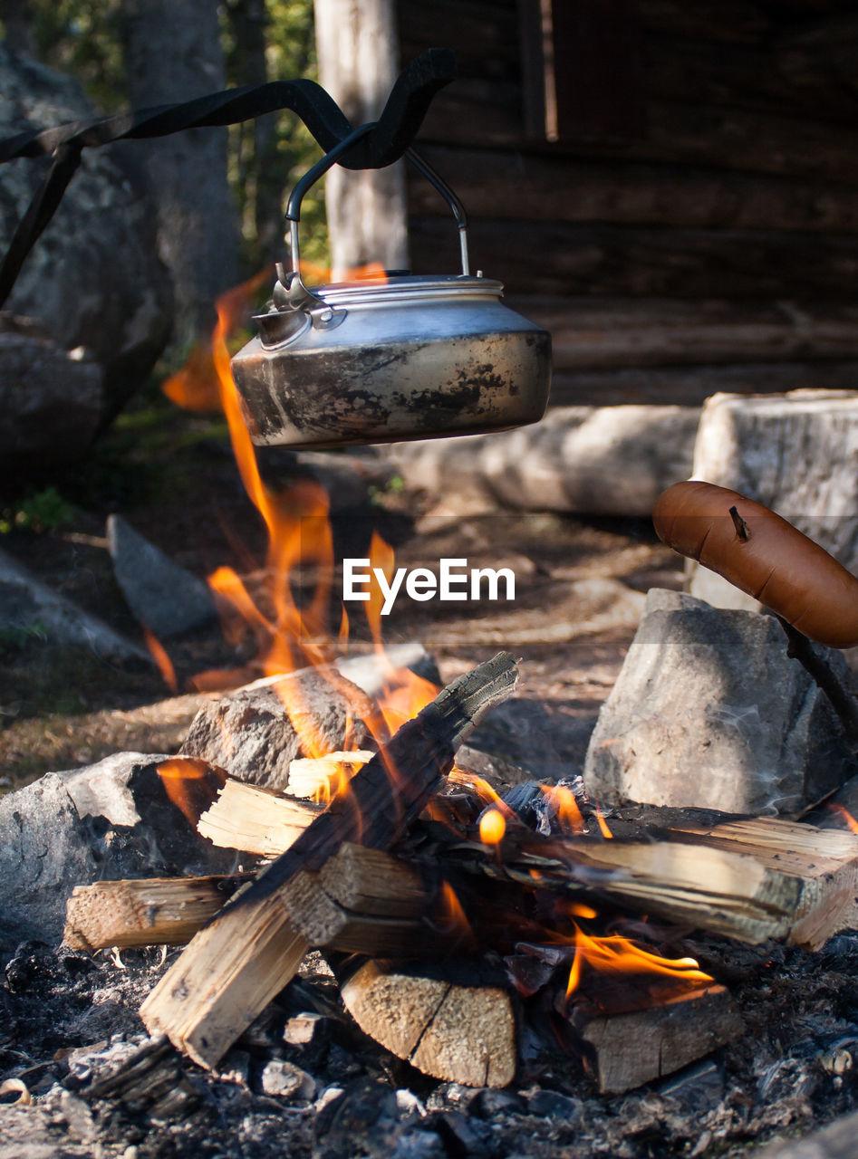 Kettle Hanging Above Bonfire
