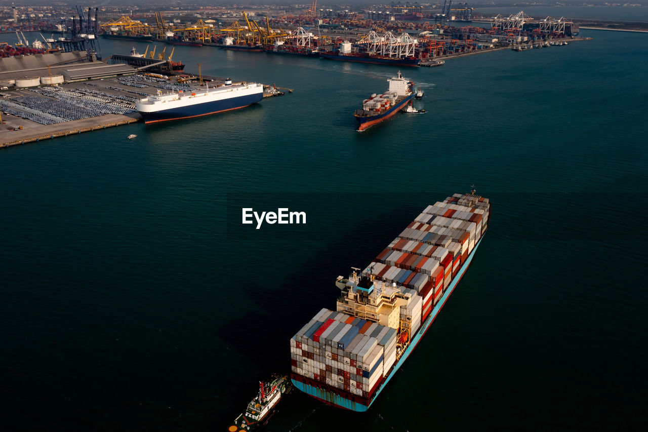 Aerial view container cargo ship carrying commercial container in import export business