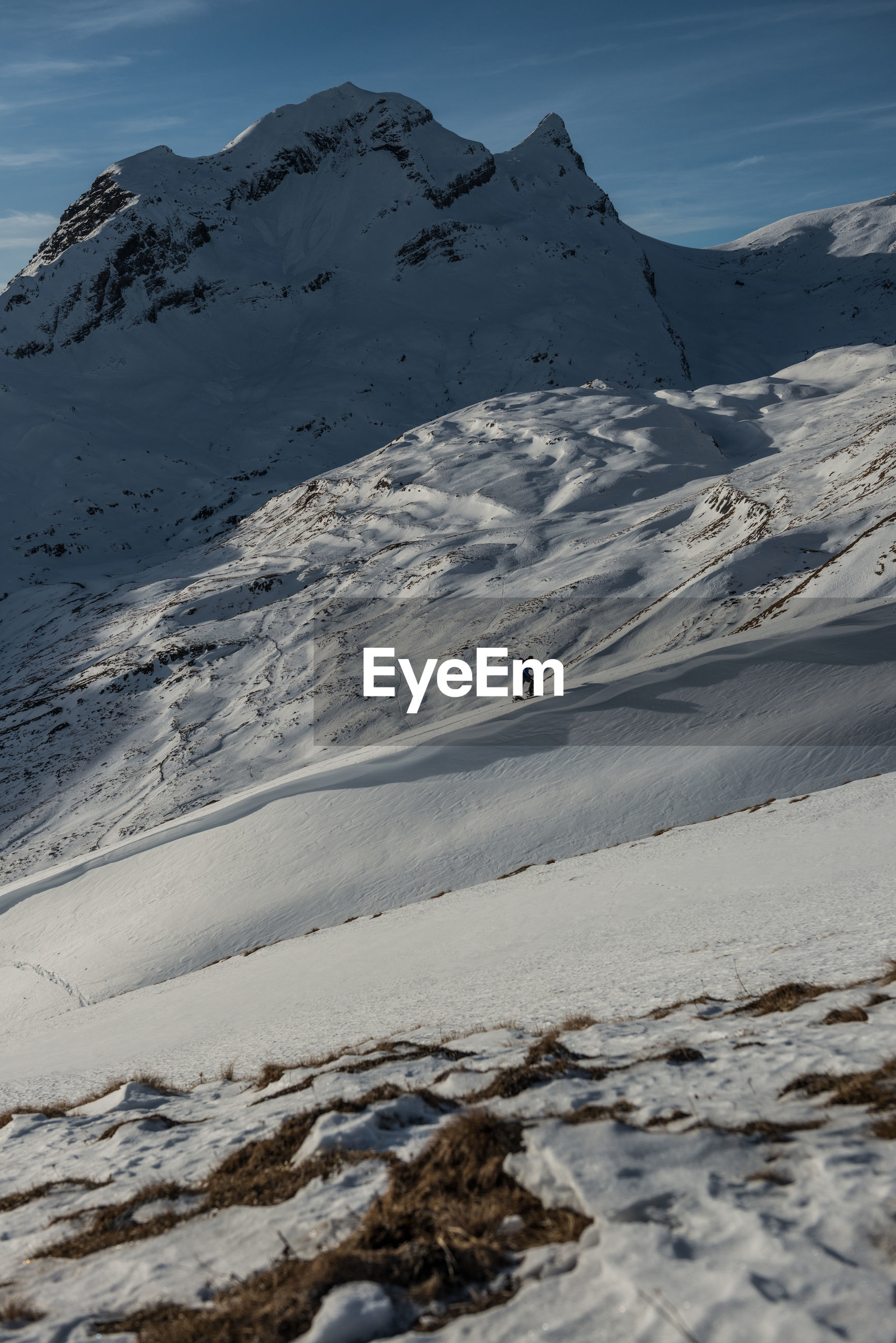 Person hiking on snowcapped mountain