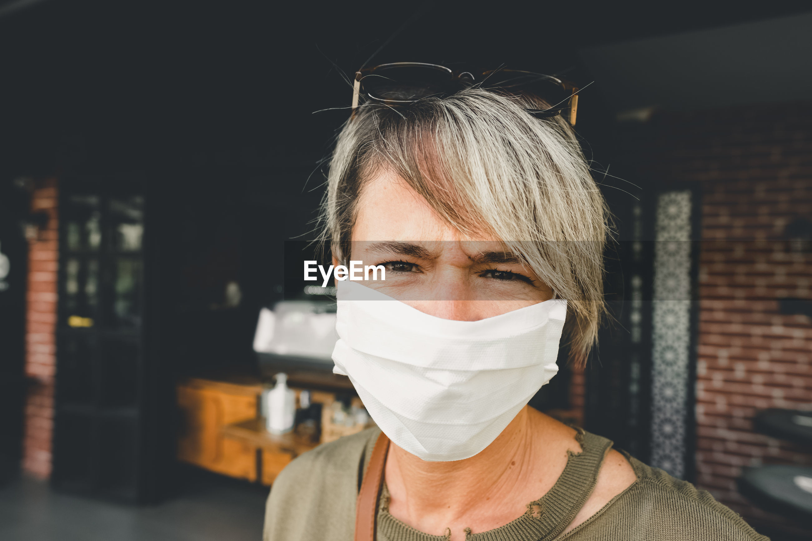 Blonde woman wearing face mask during pandemic time. portrait of an adult woman with mask.