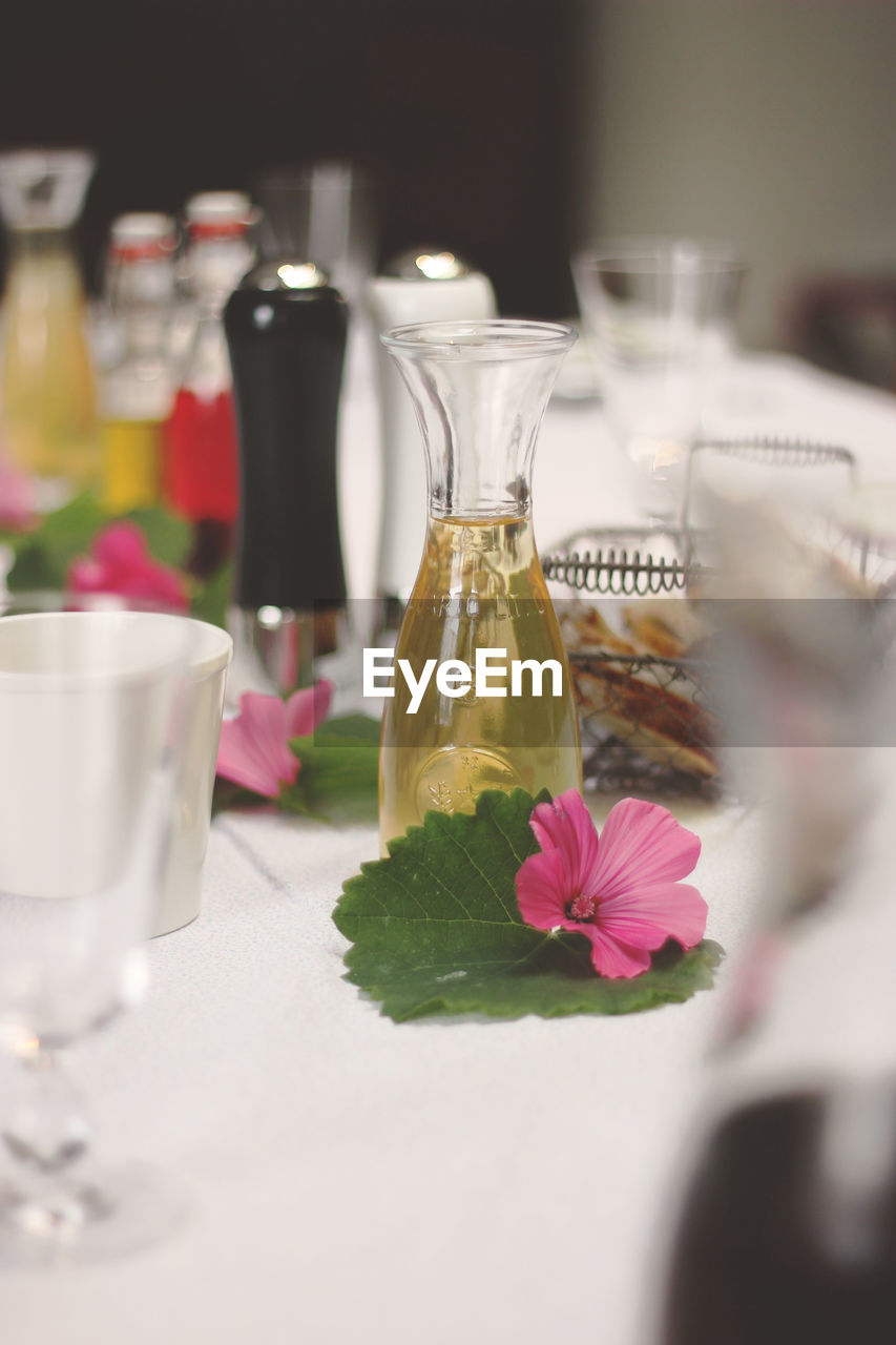 table, flower, bottle, freshness, indoors, jar, selective focus, no people, food and drink, close-up, food, nature, flower head, ready-to-eat, day