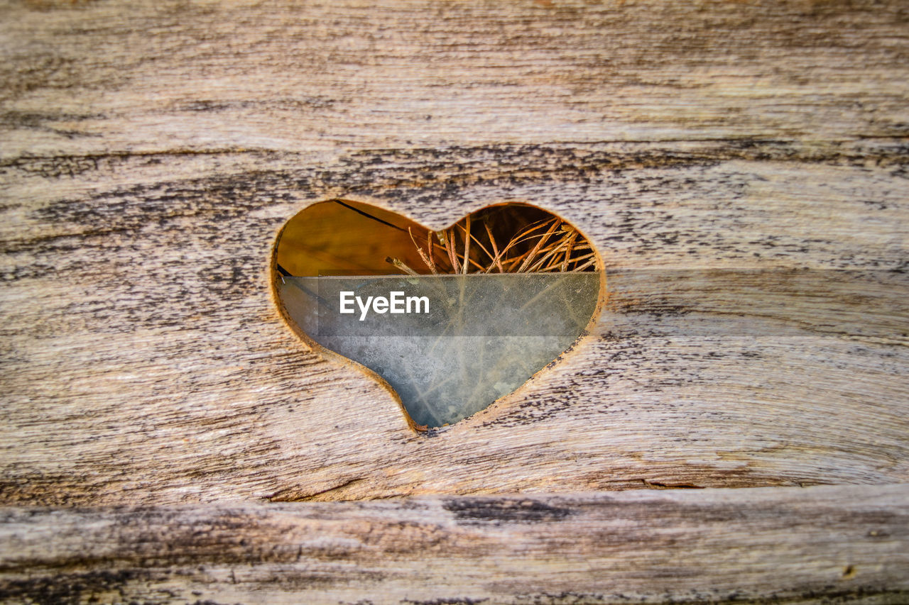 Close-Up Of Heart Shape In Wooden Plank