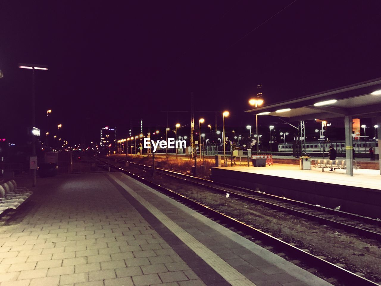 night, illuminated, railroad track, transportation, railroad station platform, rail transportation, railroad station, outdoors, no people, clear sky, sky