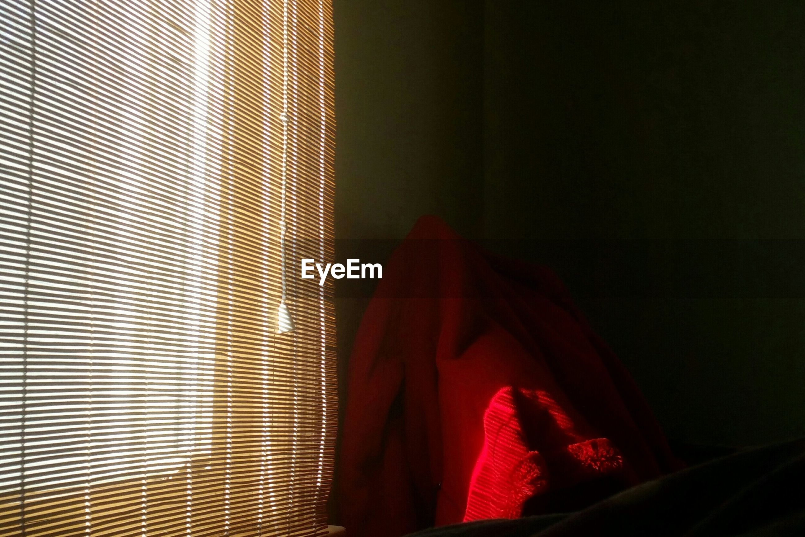 Red blanket by curtain