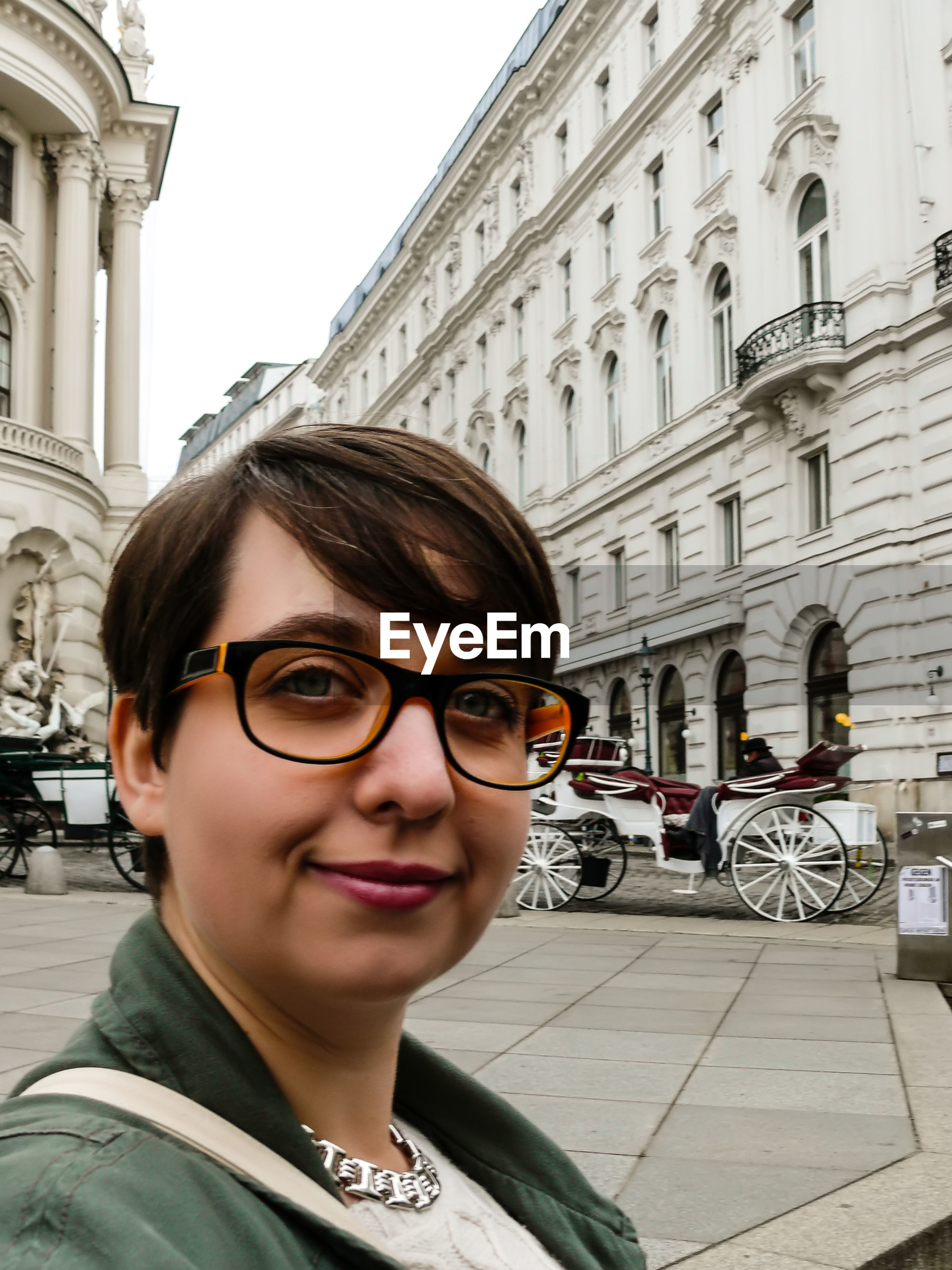 Portrait of smiling woman in city