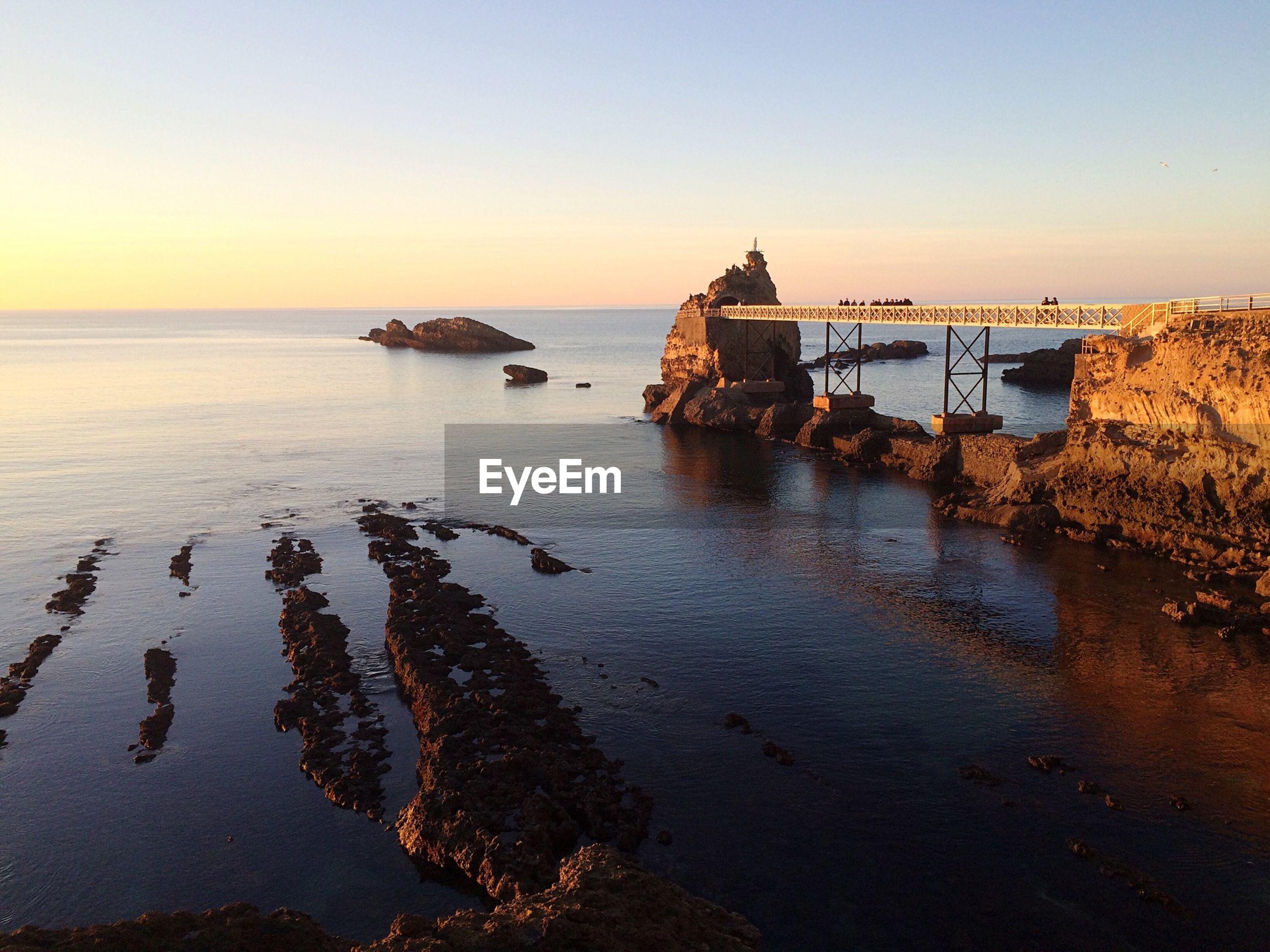Footbridge between rocks by sea
