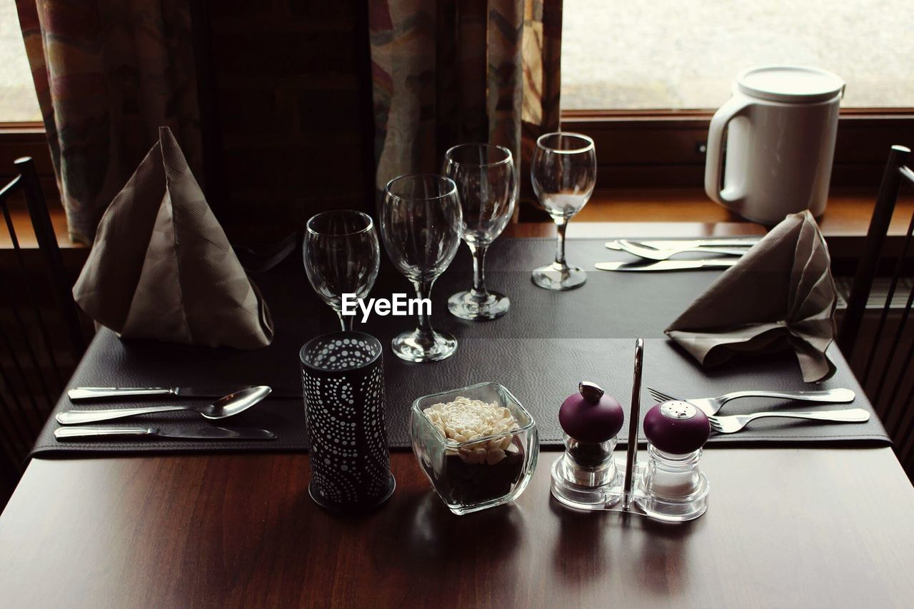 table, food and drink, drink, refreshment, glass, household equipment, drinking glass, indoors, kitchen utensil, food, eating utensil, plate, wineglass, still life, restaurant, freshness, fork, alcohol, business, no people, table knife, setting, red wine