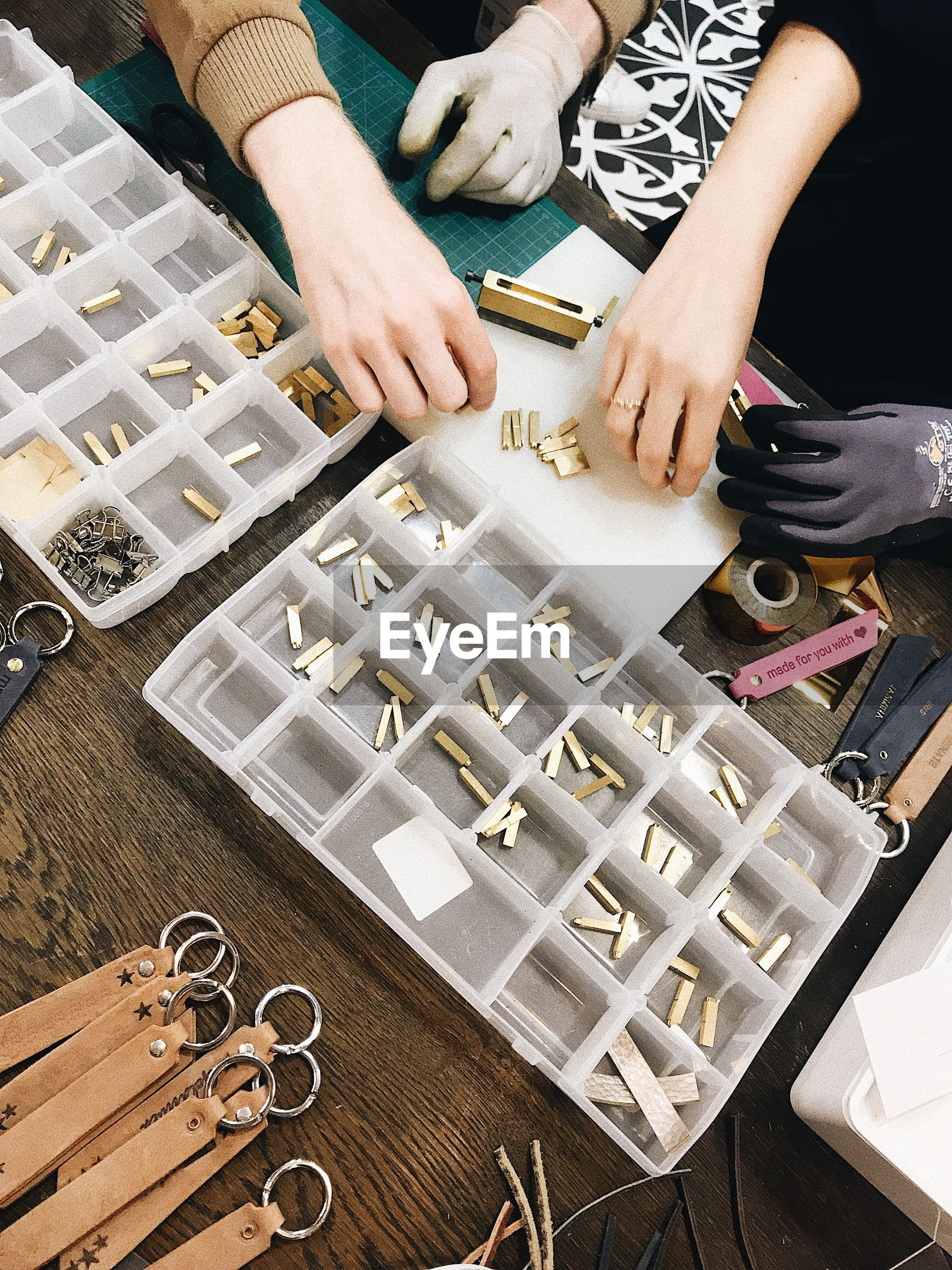 High angle view of woman making a customized fashion accessories.