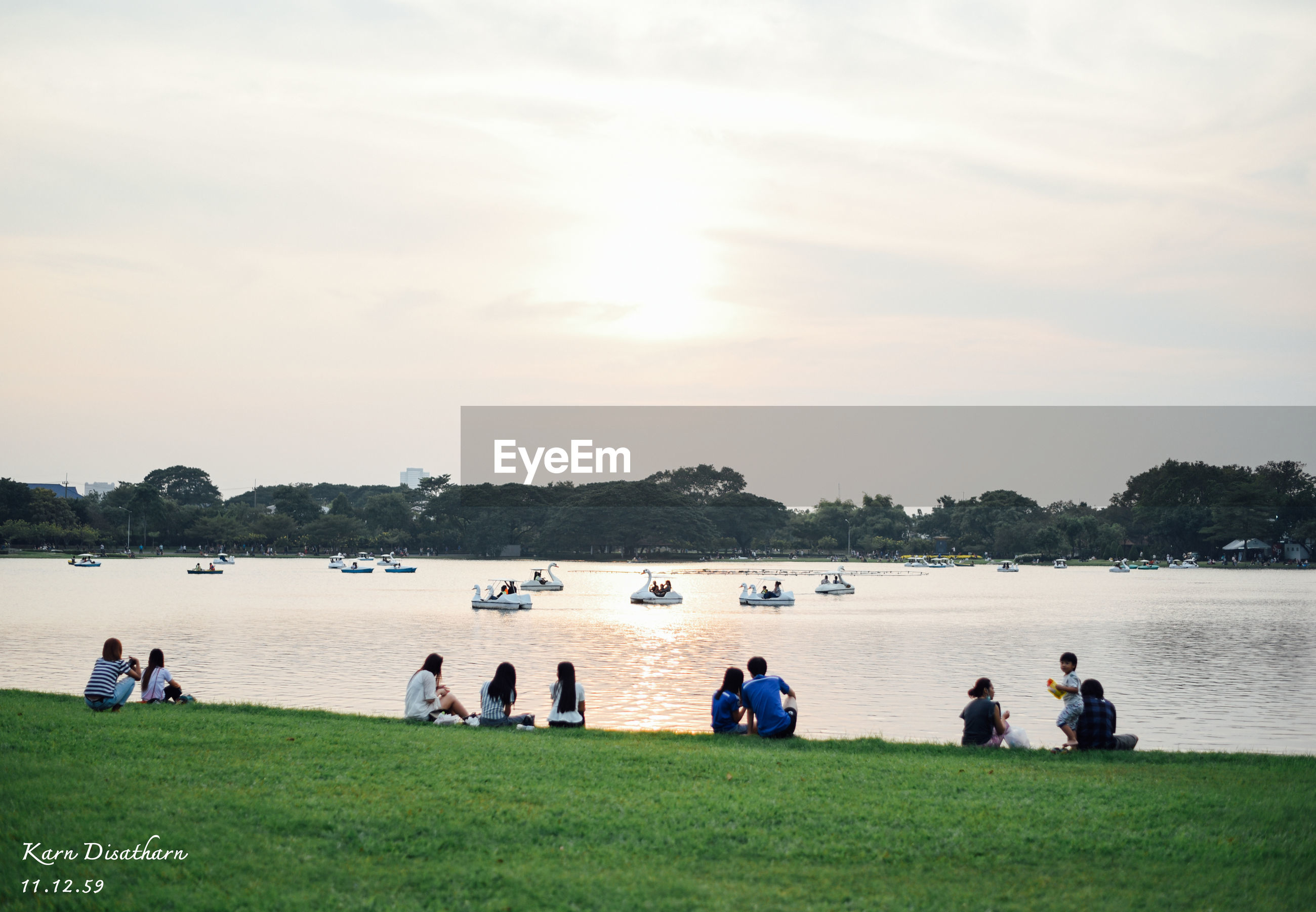 sky, large group of people, water, grass, leisure activity, real people, beach, sea, men, outdoors, tree, nature, vacations, growth, beauty in nature, cloud - sky, women, scenics, day, people, sports team, togetherness, adult, adults only